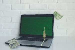 Laptop with bills