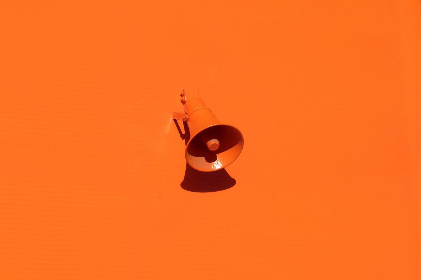 Orange wall and megaphone