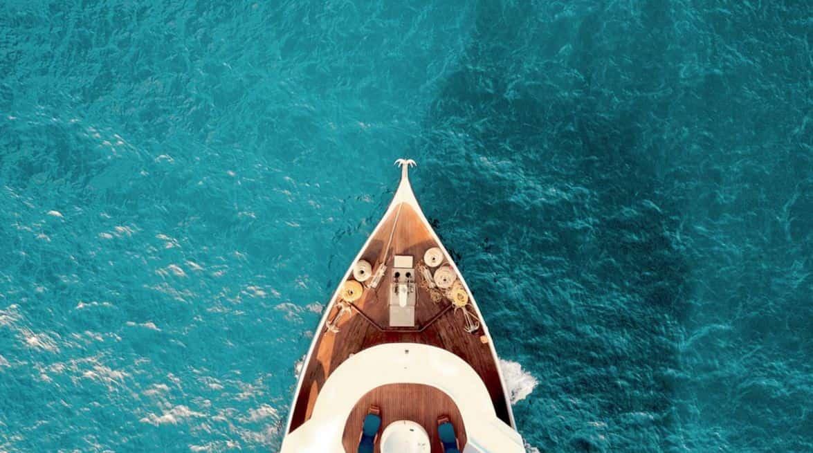 Boat floating on blue ocean