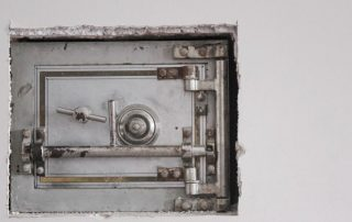 White safe box in the wall