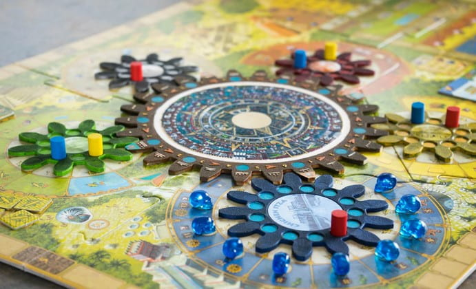 Classic board game and colorful pins