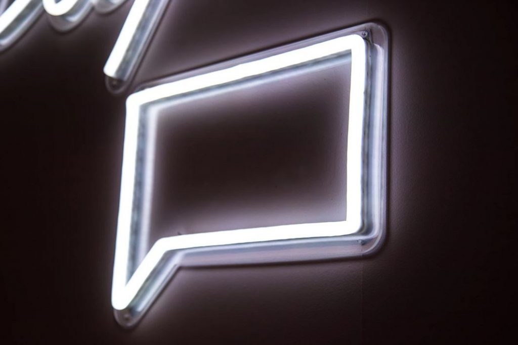 White neon comment sign