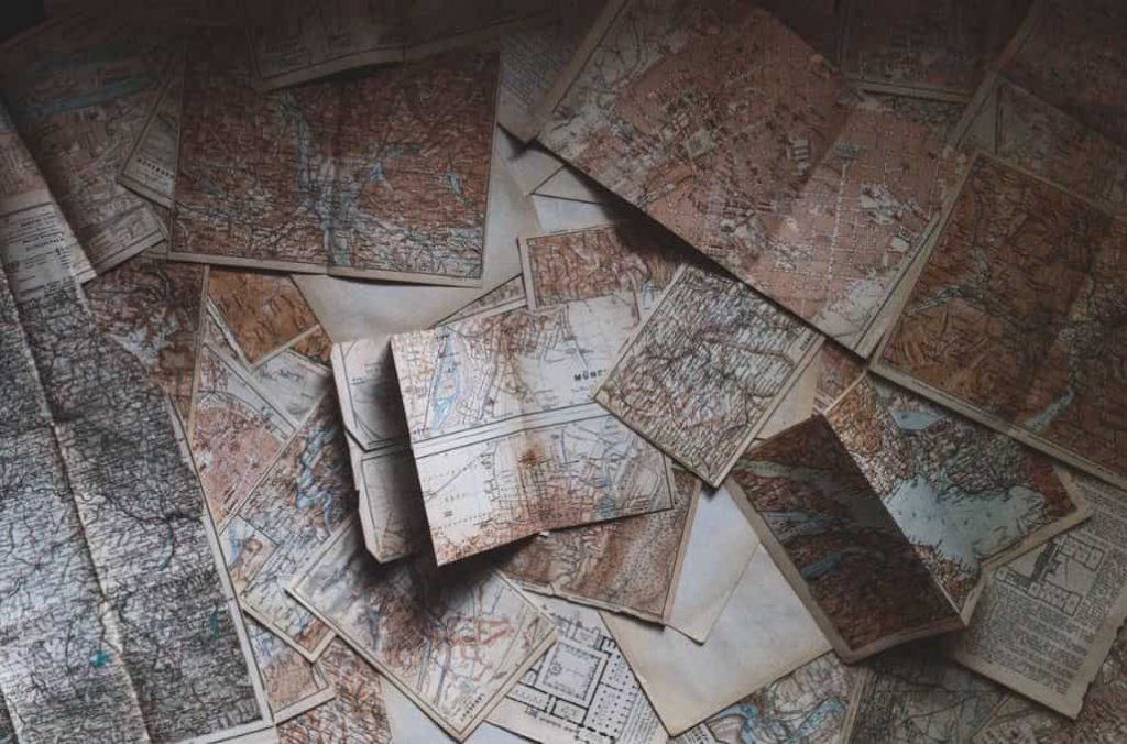 Maps spread out on a desk
